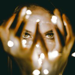 woman magician with an intense gaze