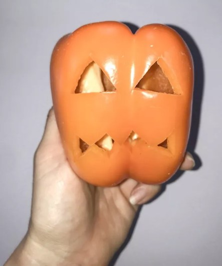 Hollow Bell Pepper Shell Carved with a pumpkin face