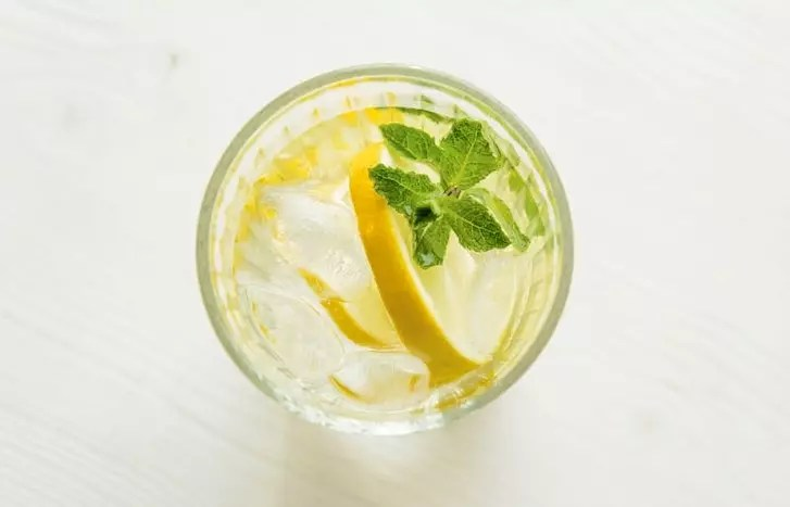 Flat lay of Iced Lemon water with mint