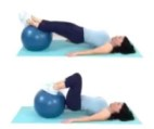 Hamstring Ball Tuck Home Leg Exercise being done by trainer Christina Carlyle https://christinacarlyle.com/home-leg-workout/