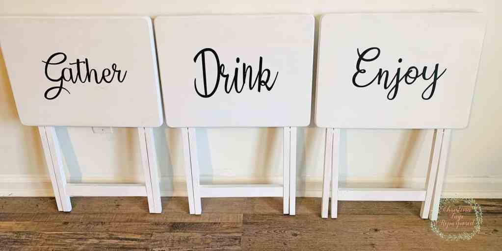 TV trays with vinyl quotes attached.