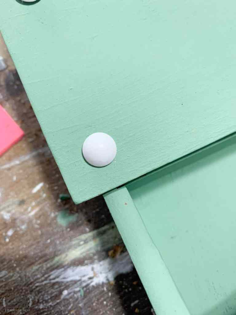 Hammering White Upholstery Tacks into Existing Tack Holes