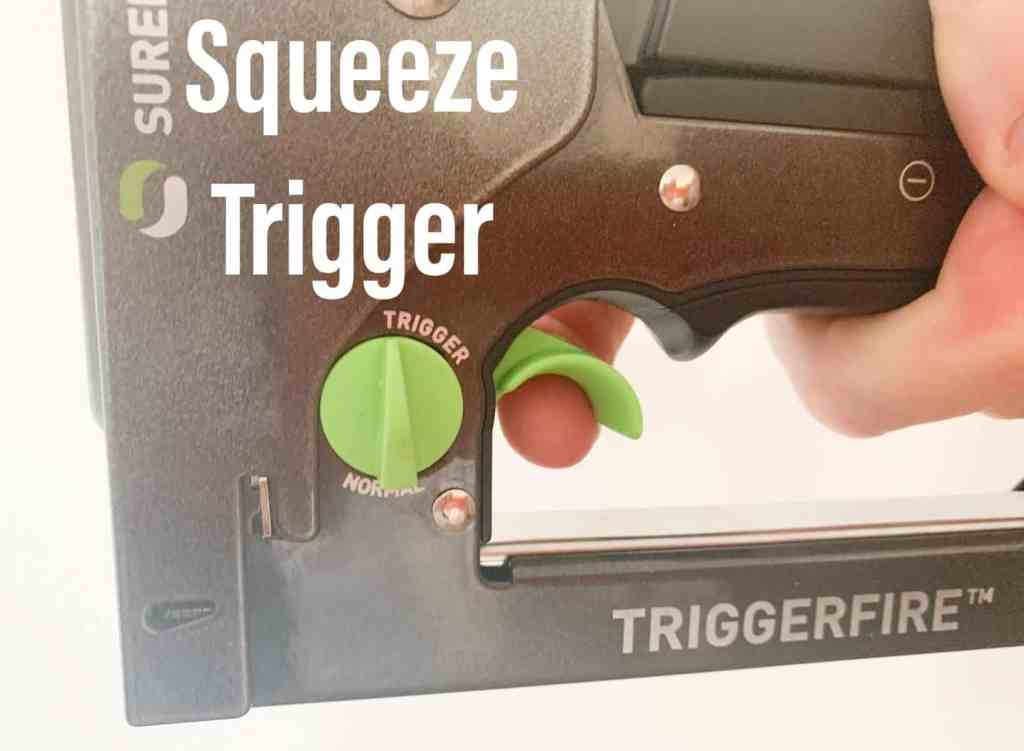 Squeeze trigger to add staple