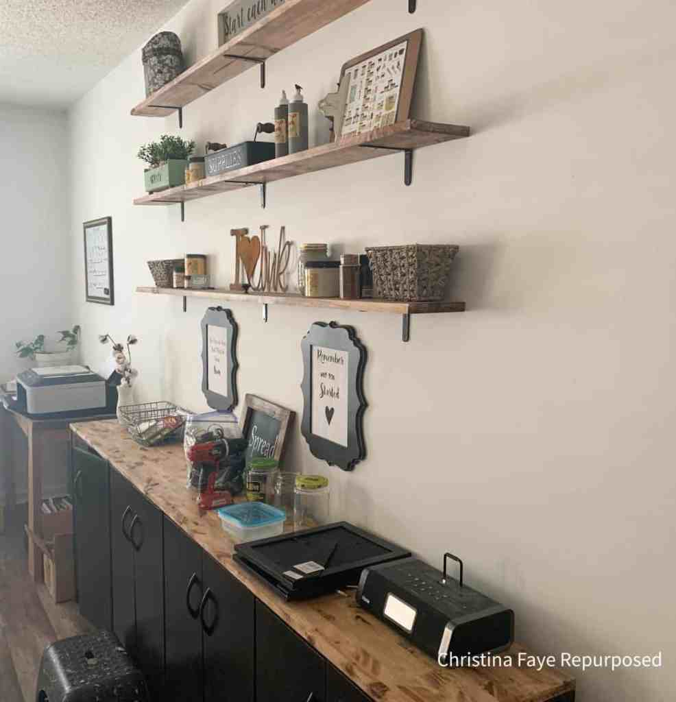 Storage cabinets with shelving above them
