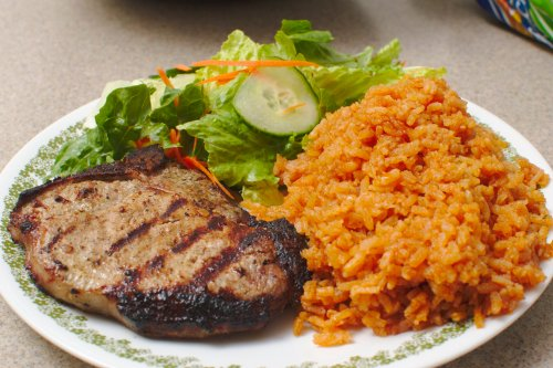 Grilled pork chop, salad, mexican rice