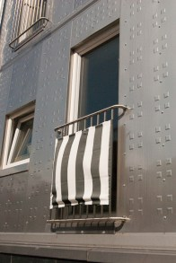 A french balcony on the stainless steel house.