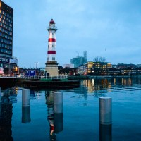 Lighthouse reflection by the Western Harbor