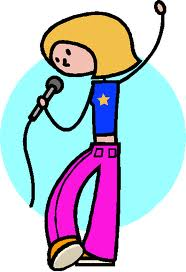 A picture of a girl singing into a microphone