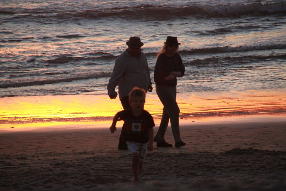 photo of a family at sunset.