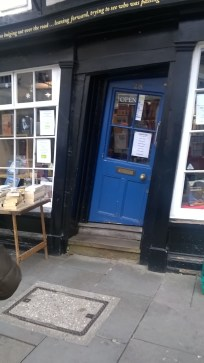 The door of the bookshop to the left of this picture