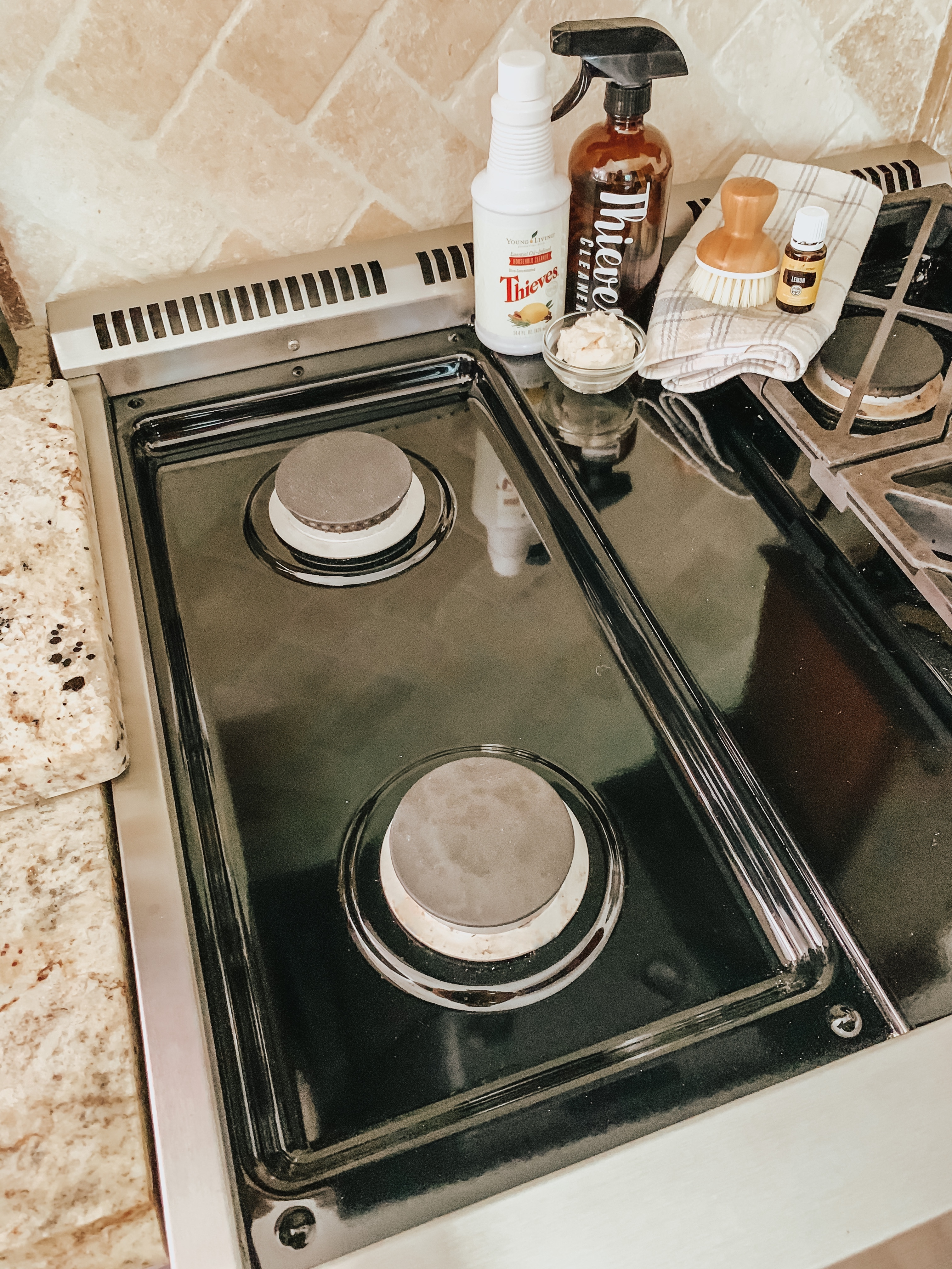 stove with natural cleaning supplies- creating a more Natural Home