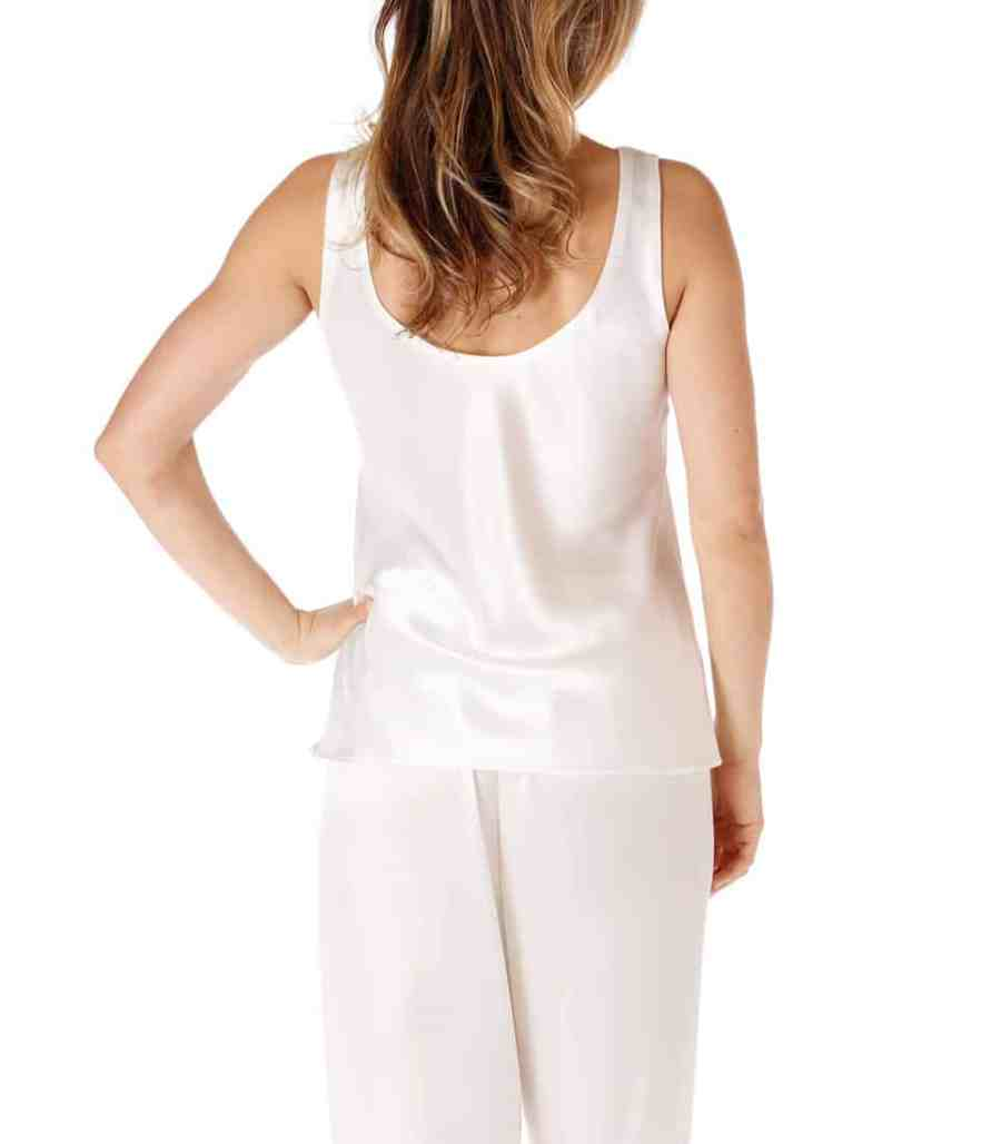 silk white camisole and lounge pant is worn by a women