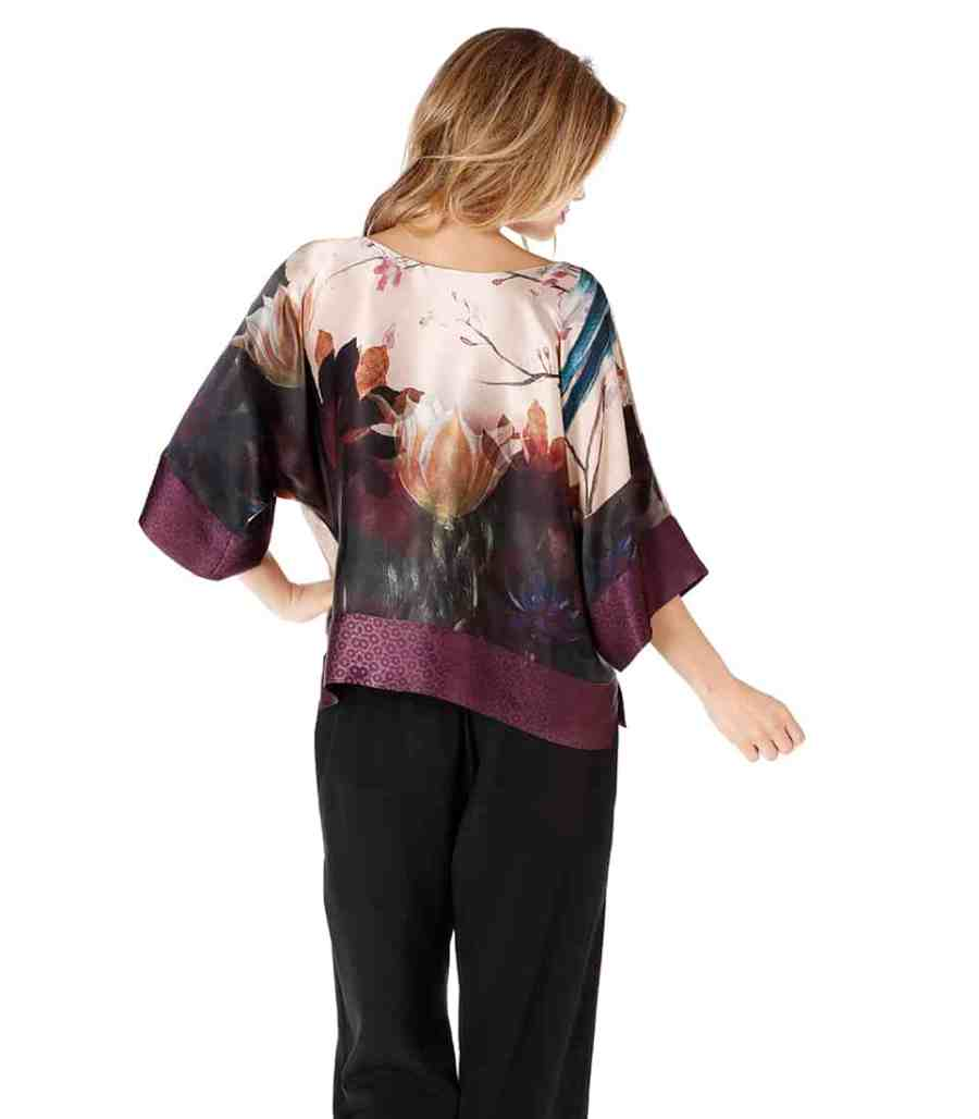 A silk lounge top in our Christine Lingerie Phoenix print is worn by a women