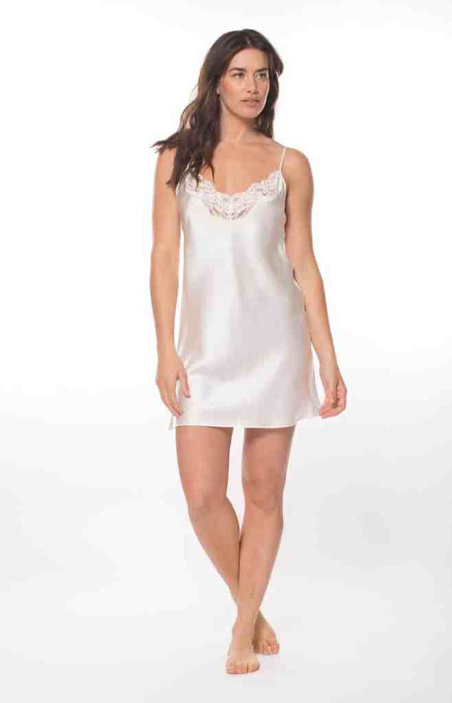 A white silk chemise with white lace is worn by a women
