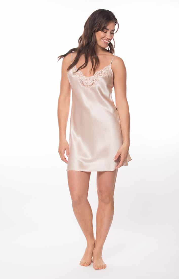 A pink silk chemise with pink lace is worn by a women