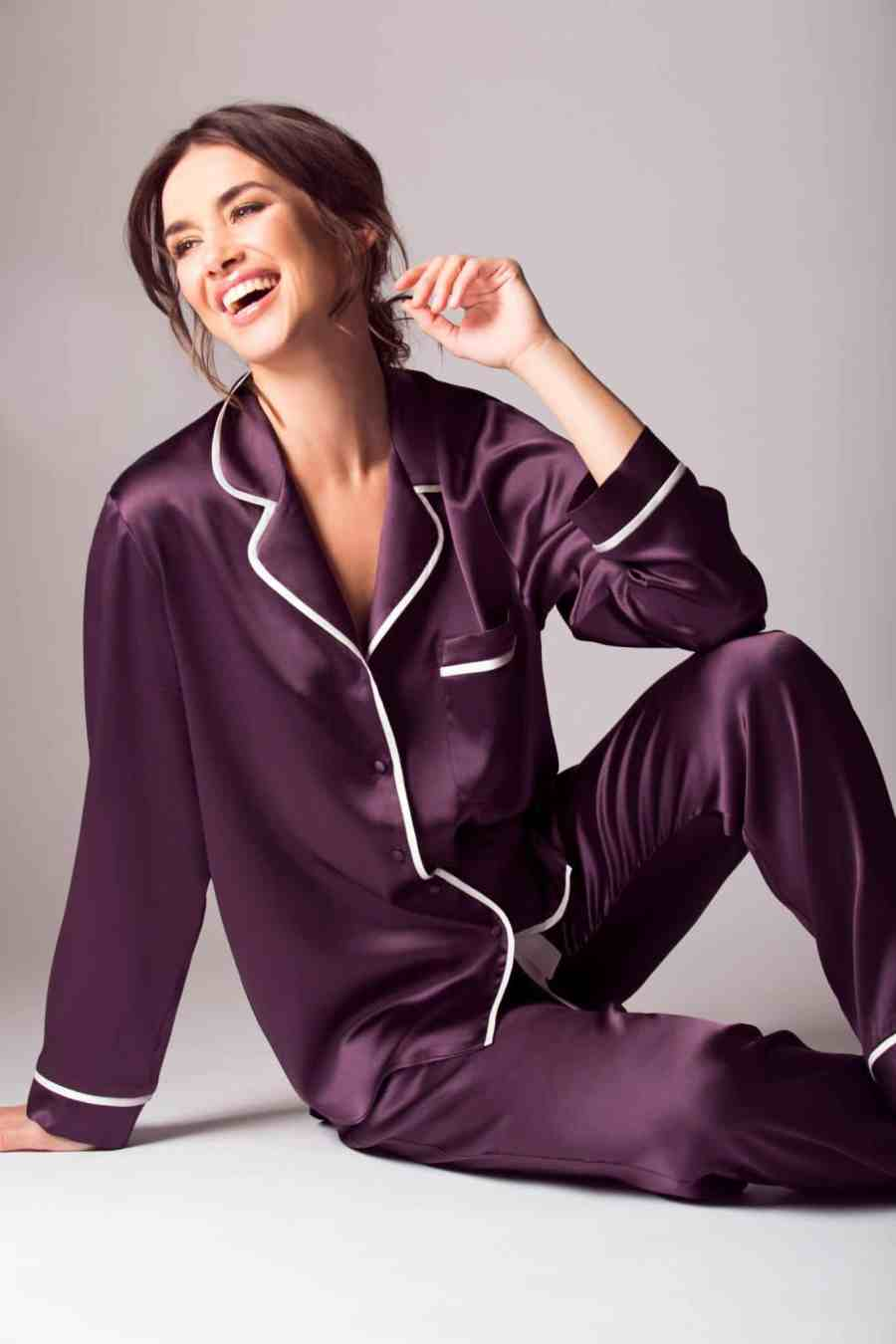 silk purple pajama with white lining is worn by a women