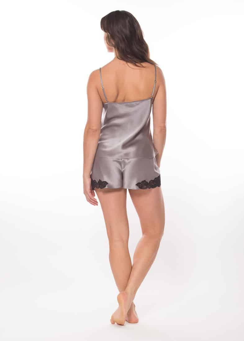 silk cami and tap set is worn by a women posed with back to camera