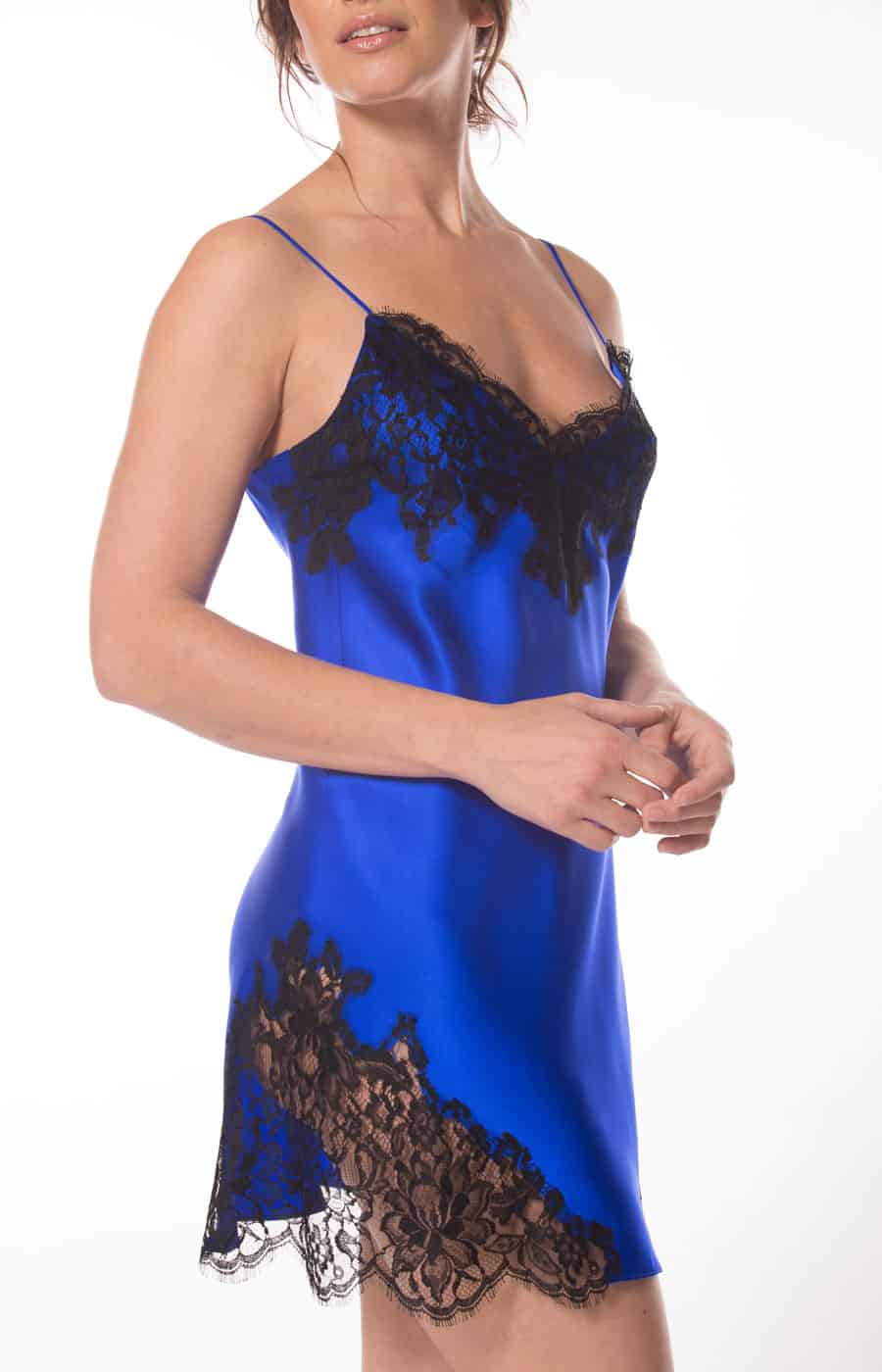 silk blue chemise with black lace is worn by a women