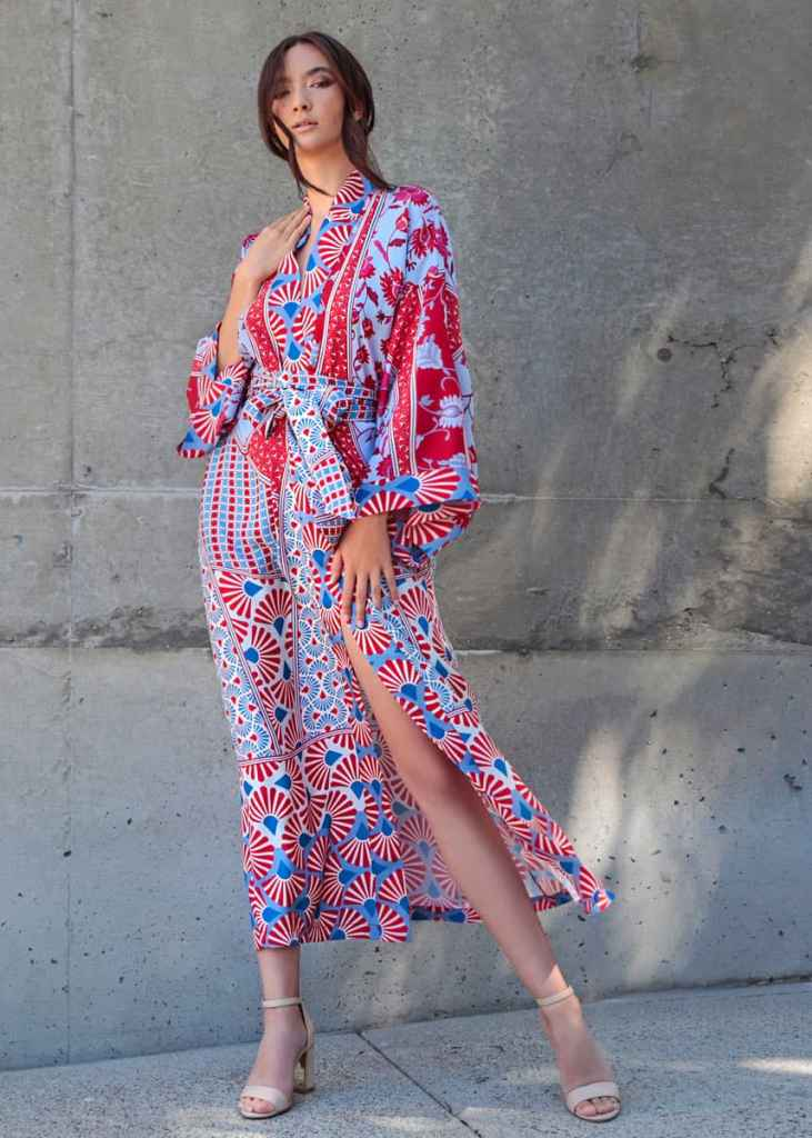 A silk long robe in our Christine Lingerie blue and red origami Gatsby print is worn by a women