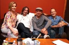 A group photo of band members: Christine, Paul, Mick, Doug