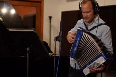 Doug Petty playing accordian at the studio.