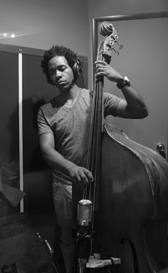 Edwin Livingston plays upright bass during the recording of the Been A Long Time album.