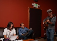Christine Rosander working out tunes in the recording studio with band members.