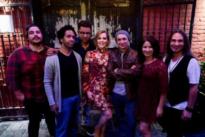 A group photo of Christine Rosander and band members.