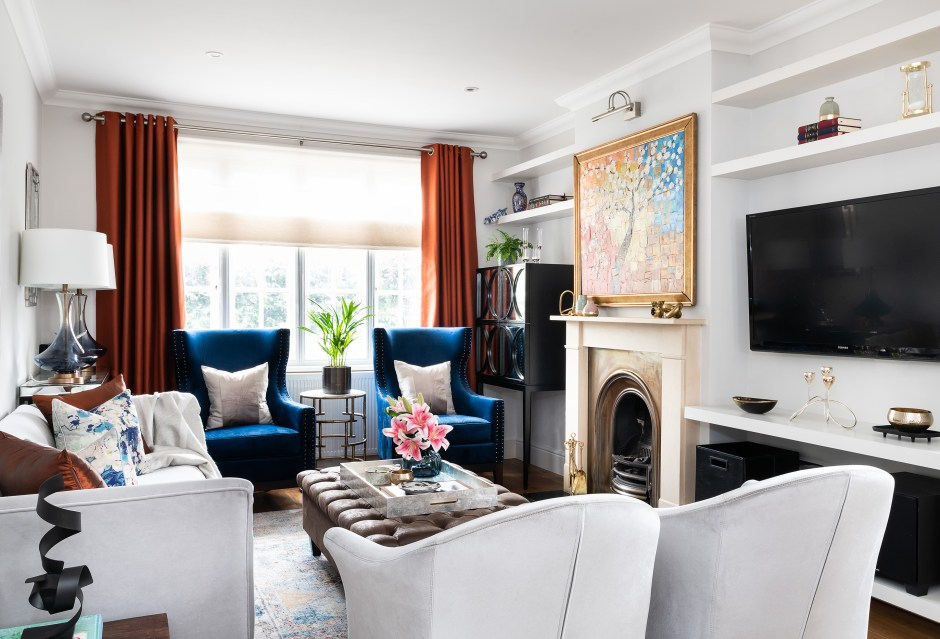 Family room refresh_Living Room_blue and copper colour scheme_Richmond_London_Christine Tse Interiors_London Interior Designer_North London Interior Designer_Copper Curtains_ brown faux leather ottoman with storage_ Blue table lamps with white shade_ mirrored brown wine cabinet storage