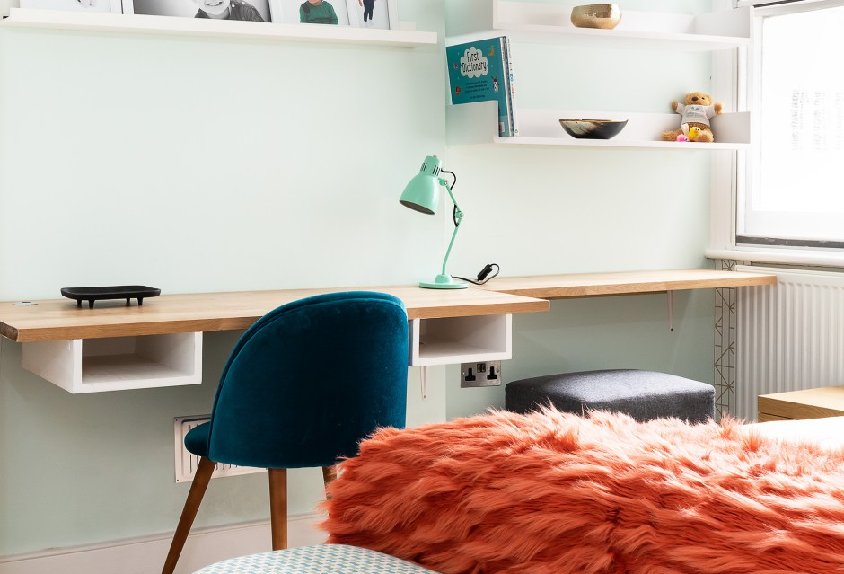 Kids Room_Nursery_Bespoke joinery_bespoke shelving_desk space_orange and turquoise colour scheme_kids rooms_Kelly Hoppen wallpaper_floating white shelves_London Interior Designer_North London Interior Designer_South Kensington_Richmond_Hampstead_Belsize Park_St Johns Wood_Chelsea and Kensington_Christine Tse Interiors_Tse Design Studio