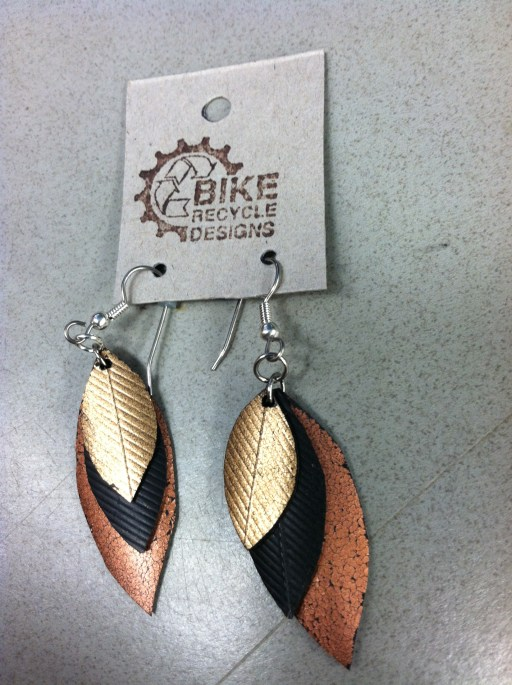 Earrings made from rubber inner tubes and painted with metallics.