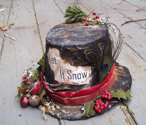 Stunning Primitive Christmas Decorations Ideas   Christmas     A delightful veranda decoration  a well worn black hat complete with a red  ribbon holly  Christmas berries and pomegranate decoration helps to set the  scene