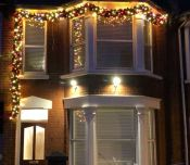 A private residence dressed in our commercial luxury garland and lit to impress!