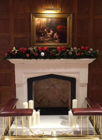 Mantle in a Mayfair store decorated by Essentially Christmas Decorating