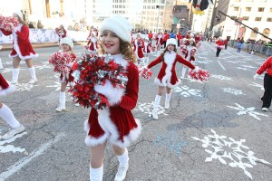 Dancers in Mrs. Claus costumes at the 2013 Ameren Missouri Thanksgiving Day Parade.