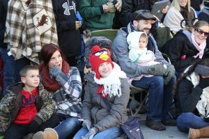 Parade goers sitting on the sidelines at the 2013 Ameren Missouri Thanksgiving Day Parade.