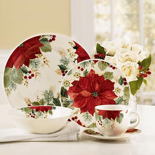 Holiday Grace Dinnerware - The Paragon. Set on a white table cloth with a Poinsetta center piece & Christmas is served