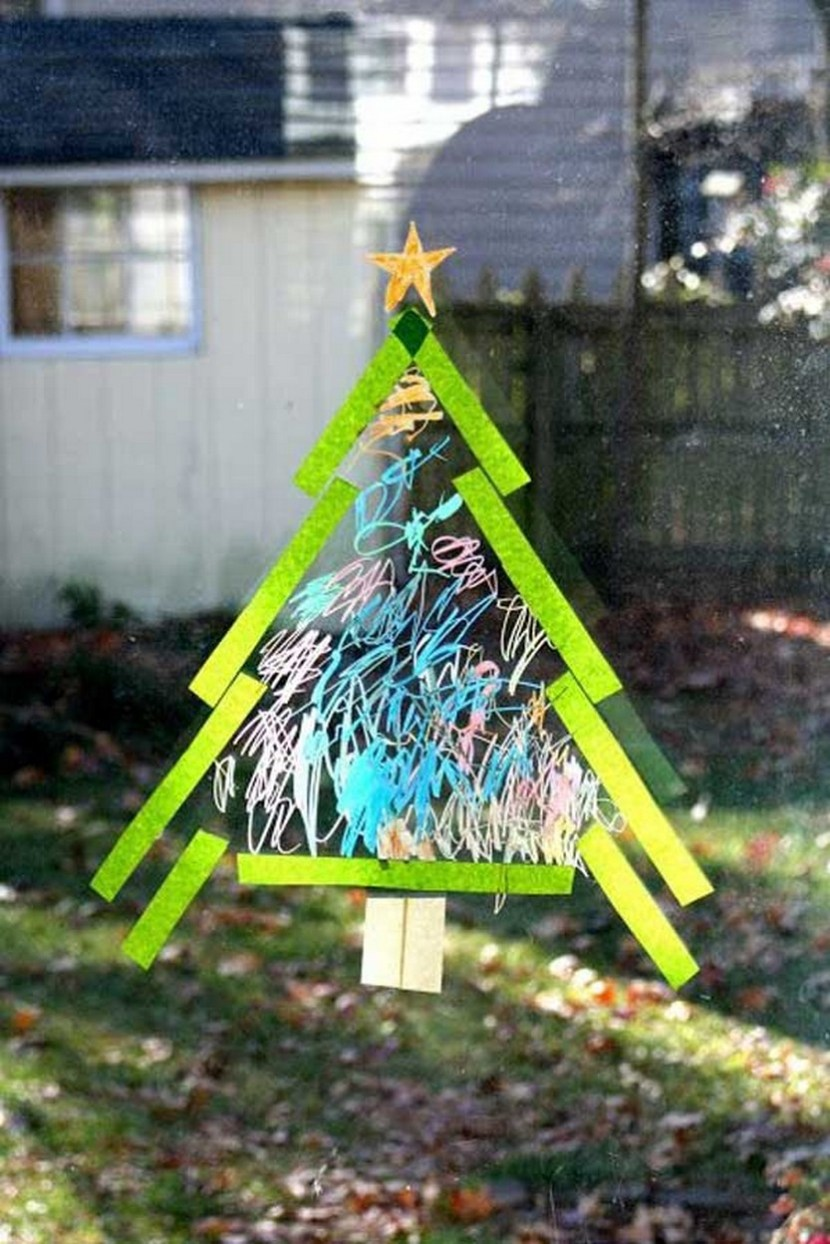 Use Crayola window markers and scotch tape to make a Christmas tree on the window