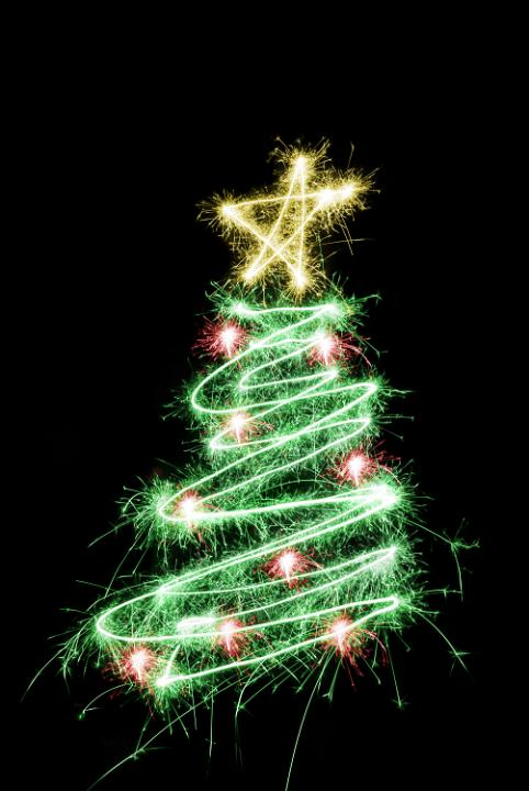 a christmas tree with star on top and red baubles all drawn with sparkler light
