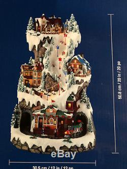 Musical LED Ski Village Tower With Rotating Train Lights Plays 8 Christmas Songs