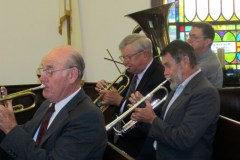 Orchestra members playing Sunday morning