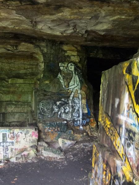 Cavewoman, graffiti. Deliveranceville quarry.