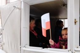 Kid waving polish flag
