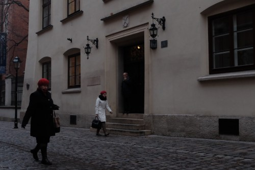Two women in red hats by jagalonia university
