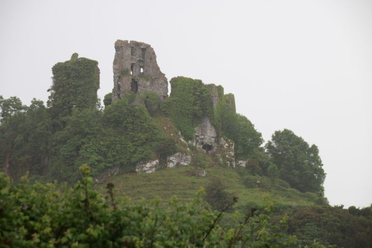 The ruins of Carrigogunnell Castle, near Limerick, Ireland, seen atop their hill from the east