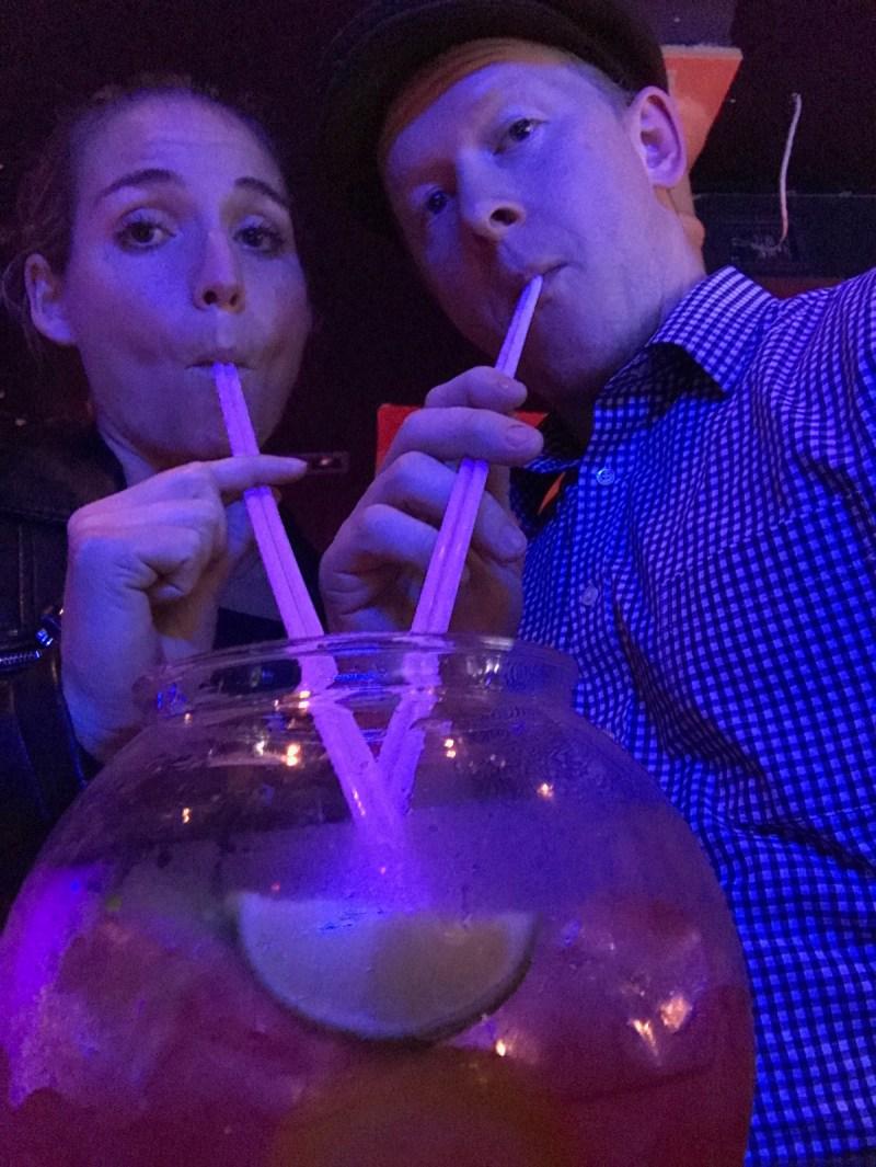 Sucking down a fishbowl full of booze at Chambers gay bar in Cork City, Ireland