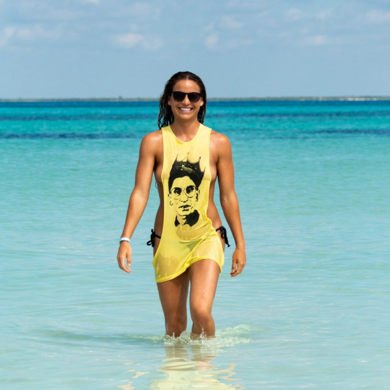 Corky, wearing only a wet yellow tank top with the image of Ruth Bader Ginsburg, emerges from the ocean. Photo by Christopher Keelty.
