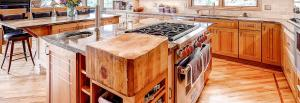 Rustic transitional kitchen with cherry and oak cabinets and built in butcher block.
