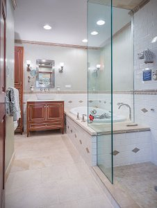 Traditional master bathroom with Thermasol steam shower, BainUltra air bath and Axor Montreux fixtures.