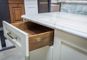 Hallmark traditional custom cabinetry with walnut drawer box and shaker door style with quartzite countertops.